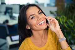 Businesswoman talking on the phone in office Royalty Free Stock Photography