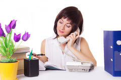 Businesswoman talking on phone at office Stock Images