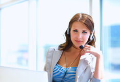 Businesswoman talking phone while working on her computer at the office Stock Photography