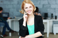 Businesswoman talking on the phone Stock Photos
