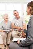 Businesswoman talking with senior couple Royalty Free Stock Image