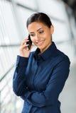 Businesswoman talking on smart phone Stock Image