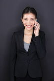 Businesswoman talking on smart phone happy Royalty Free Stock Images