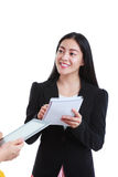 Businesswoman talking with some body and holding note paper, on. Businesswoman talking with someone holding using digital tablet. Asian woman tooth smile, she Royalty Free Stock Image