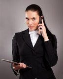 Businesswoman talking on telephone  with tablet pc Stock Photos