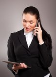 Businesswoman talking on telephone  with tablet pc Stock Images