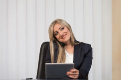 Businesswoman Talking On Telephone And Using Computer Stock Photography