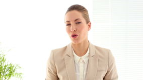 Businesswoman talking to the camera