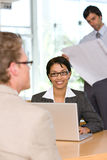 Businesswoman talking to client Royalty Free Stock Images
