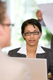 Businesswoman talking to client Stock Image