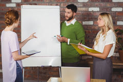 Businesswoman talking to colleagues Royalty Free Stock Image