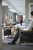 Businesswoman Talking To Cropped Man In Office Stock Photo