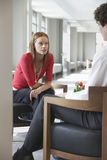 Businesswoman Talking To Cropped Man In Office Stock Photography