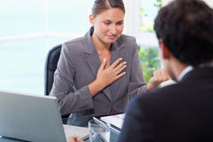 Businesswoman talking to customer Stock Image