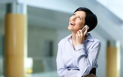 Businesswoman talks on cellphone Stock Photography