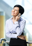 Businesswoman talks on mobile Royalty Free Stock Image