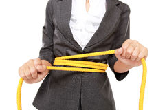 Businesswoman tangled rope on her body Stock Photography