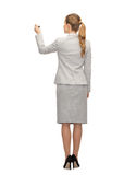 Businesswoman or teacher with marker from back Stock Photos