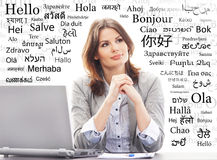 Businesswoman or teacher in office. Different world languages Royalty Free Stock Photos