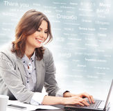 Businesswoman or teacher in office. Different world languages Royalty Free Stock Photography