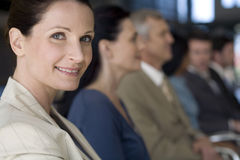 Businesswoman with team Royalty Free Stock Photography