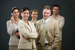 Businesswoman and team Stock Image