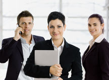 Businesswoman with team Stock Images