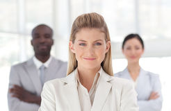 Businesswoman with team Royalty Free Stock Photo