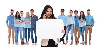 Businesswoman team leader holds bubble speech while talking on p. Businesswoman team leader holds empty bubble speech while talking on the phone and standing on stock photography