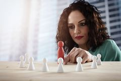 Businesswoman team leader thinks about the strategy of company team. Businesswoman team leader thinks about the strategy of team resource stock images
