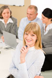 Businesswoman at team meeting with colleagues Royalty Free Stock Photos