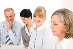 Businesswoman at team meeting with colleagues Stock Photo
