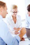 Businesswoman with team on meeting in office Stock Image