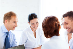 Businesswoman with team on meeting in office Stock Photos