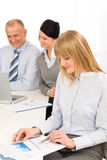 Businesswoman at team meeting study report Stock Images
