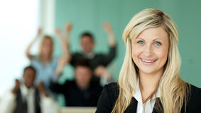 Businesswoman and the team in an office Stock Image