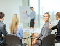 Businesswoman with team showing thumbs up Royalty Free Stock Images