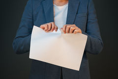 Businesswoman tearing business legal agreement contract Stock Image