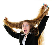 Businesswoman tearing her hair Stock Images