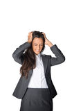 Businesswoman tearing at her hair in frustration Royalty Free Stock Images