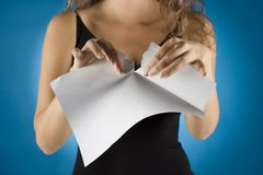 Businesswoman tears contract. Woman tears white piece of paper Royalty Free Stock Image