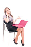 Businesswoman with telephone on chair Stock Photos