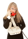 Businesswoman with telephones Royalty Free Stock Photo
