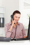 Businesswoman telephoning at workplace Royalty Free Stock Photography