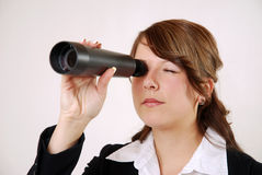Businesswoman with telescope Stock Photography