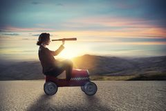 Businesswoman with telescope on a car looks for new business opportunity royalty free stock photos
