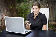 Businesswoman teleworking at home. On a Laptop. Smiling Stock Image