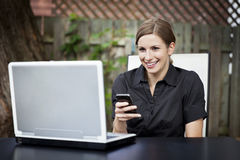 Businesswoman teleworking at home. On a Laptop. Smiling stock photo