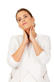Businesswoman with terrible throat pain.  Royalty Free Stock Images