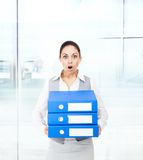 Businesswoman terrified hold stack folder Royalty Free Stock Photography